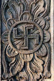 image of swastika  - Detail of hindu temple with swastika symbol Indonesia - JPG