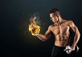 foto of combustion  - Handsome power athletic man bodybuilder doing exercises with dumbbell - JPG