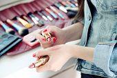 foto of makeup artist  - Female makeup artist with cosmetics at work close - JPG