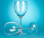 foto of champagne glasses  - Two empty champagne glasses on blue background - JPG
