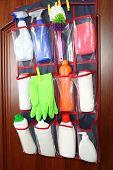 pic of detergent  - Different detergents in hanging bag wooden door - JPG
