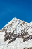 foto of andes  - Snowy mountain peak in the Andes mountains near Huaraz Peru - JPG