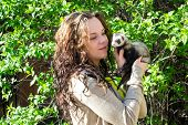 image of ferrets  - The girl with homemade ferret in hands on a walk - JPG