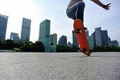 picture of skateboarding  - skateboarder doing skateboarding trick ollie on city - JPG