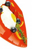 foto of scrambled eggs  - fried scrambled eggs eye with white goat feta cheese on red plate isolated over white background with black olives and vegetables - JPG