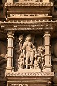 stock photo of kamasutra  - Stone carved erotic sculptures on Vamana Temple - JPG