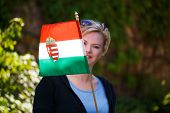 picture of hungarian  - Blonde woman with Hungarian flag outdoor portrait - JPG