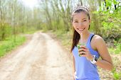 pic of smoothies  - Healthy woman drinking green smoothie wearing smartwatch - JPG