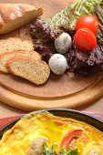 image of quail egg  - bread tomatoes lettuce and quail eggs on a wooden cutting board - JPG