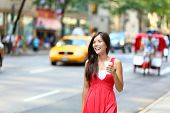 picture of cabs  - Casual young urban woman drinking coffee happy smiling in New York City - JPG