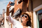 picture of funky  - Beautiful young funky woman making selfie while standing outdoors - JPG