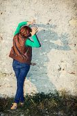 picture of cuckold  - Young caucasian woman making shadows shapes with her hands in front of the old wall - JPG