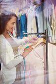 foto of blouse  - Female choosing new blouse in boutique - JPG