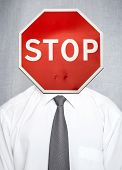 image of ban  - Man in white shirt with tie over gray background with stop road sign as a head - JPG
