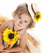 stock photo of scarecrow  - Adorable toddler dressed as a scarecrow and looking up at the camera - JPG