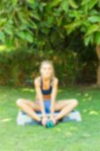 stock photo of step aerobics  - Young woman during her outdoor step workout - JPG