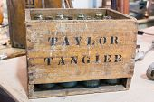 picture of crate  - empty bottles in vintage wodden crate, box ** Note: Soft Focus at 100%, best at smaller sizes - JPG