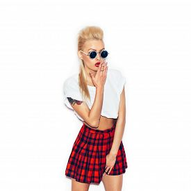 picture of up-skirt  - Girl in a white shirt and plaid skirt and sunglasses having fun - JPG