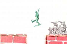 image of ravines  - Green army man jumps ravine to escape gray army - JPG