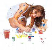 stock photo of dessin  - Happy girl stained in paint drawing dessin - JPG