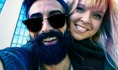 Постер, плакат: Bearded Man And Girlfriend Taking Selfie Playing Piggyback Hipsters Couple Having Fun With Mobile