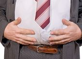 stock photo of fat-guts  - the detailed look at belly of fat businessman - JPG