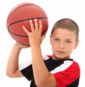picture of crew cut  - Adorable six year old boy child with basketball in uniform over white background - JPG