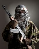 stock photo of terrorist  - Portrait of serious eastern man with AK - JPG