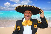 Charro mariachi man portrait shouting in Mexico Caribbean beach