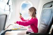 Child In Airplane. Fly With Family. Kids Travel. poster