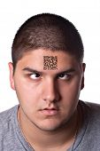 image of qr-code  - A young man that looks very tired and cross eyed with his eyes looking upward towards his forehead - JPG