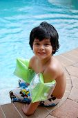 An adorable Hispanic boy in the pool