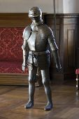 stock photo of castrate  - Heavy Medieval knight guarding in old palace - JPG