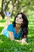 picture of close-up middle-aged woman  - Pretty middle aged casual woman smiling in summer park - JPG