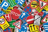 stock photo of traffic sign  - Chaotic collection of traffic signs from the United Kingdom - JPG