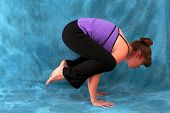 Right Side View Of Woman In Yoga Crow Pose