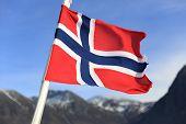 Norwegian Flag Over Norwegian Fjords Background. Shallow Dof poster