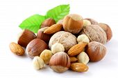 mix nuts - walnuts, hazelnuts, almonds on a white background