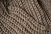 Knitted Horizontal Textured Brown Fabric On A White Background. Fragment Of A Brown Color Sweater. T poster