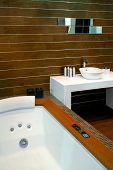 pic of lavabo  - Contemporary bathroom with wooden walls and spa bathtub - JPG