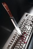 Cyber Crime With Knife Stabbing Computer Keyboard