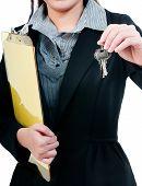 Businessperson Holding Keys