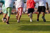 Running Children, Young Athletes Run In A Kids Run Race, Running On Grass Detail On Legs, Running In poster