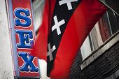 picture of stripping women window  - Red light district sex sign with Amsterdam flag - JPG