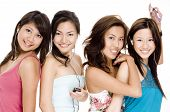 picture of foursome  - four pretty young women listening to music on their mp3 players - JPG