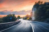 Mountain Road At Sunset With Motion Blur Effect. Asphalt Road And Blurred Background With Rocks, Ora poster