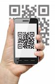 picture of mobile-phone  - Scanning QR code with mobile phone on white background - JPG