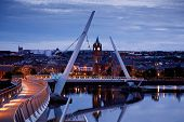 Derry, Ireland. Illuminated Peace Bridge In Derry Londonderry, City Of Culture, In Northern Ireland  poster