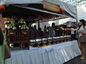 Wat Pathum Wanaram Bangkok - March 7 2012 - donate to build her birthday diurnal Buddha icon.