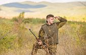 Hunter Hold Rifle. Focus And Concentration Of Experienced Hunter. Hunting And Trapping Seasons. Man  poster